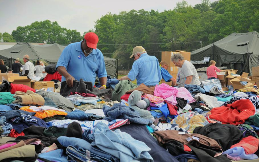 A veteran sorts through donated clothes during the Department of Veterans Affairs' Annual Stand Down Against Homelessness at the Hickory Legion Fairgrounds in Hickory, N.C., on April 2012.