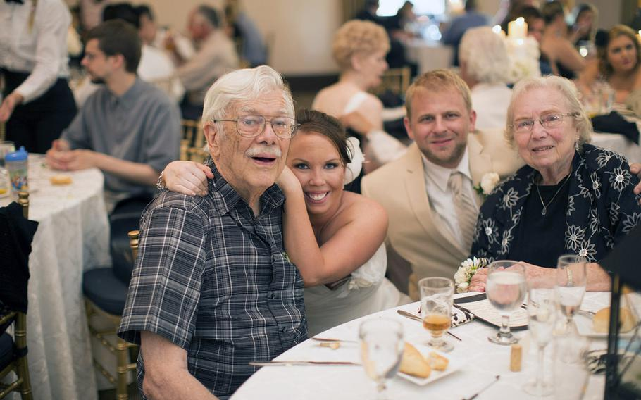 William Bailey, left, saw his granddaughter, Shannon Rasmussen, second from left, marry Jeff Herron, second from right, with his wife, Elizabeth Bailey, right. It was his last public event before he died.