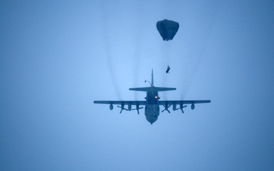 Paratroopers with the 4th Infantry Brigade Combat Team (Airborne), 25th Infantry Division, leap from the tailgate of a C-130 Hercules Alaska Air National Guard aircraft on Dec. 12, 2013 at the Malemute Drop Zone at Joint Base Elmendorf-Richardson, Alaska. The soldiers jumped with arctic combat gear as part of training for operations in northern Alaska next year.