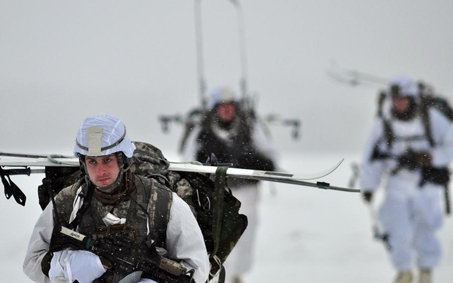 Army 1st Lt. David Pearson, of Carlisle, Pa., assigned to the 1st Squadron (Airborne), 40th Cavalry Regiment, moves off the drop zone after conducting an Arctic airborne operation in the complete over-white uniform on Malemute Drop Zone at Joint Base Elmendorf-Richardson, Alaska, Dec. 12. This is the first Arctic airborne operation for the brigade since its redeployment from Afghanistan last year.