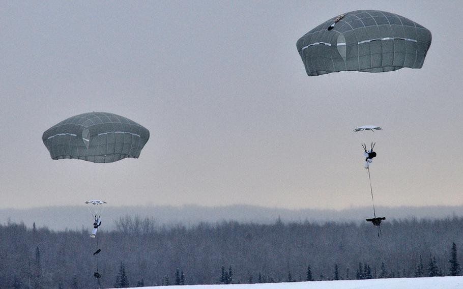 Paratroopers with the 1st Squadron (Airborne), 40th Cavalry Regiment prepare for their parachute landing fall during an Arctic airborne operation in the over-white uniform on Malemute Drop Zone at Joint Base Elmendorf-Richardson, Alaska, Dec. 12, 2013.