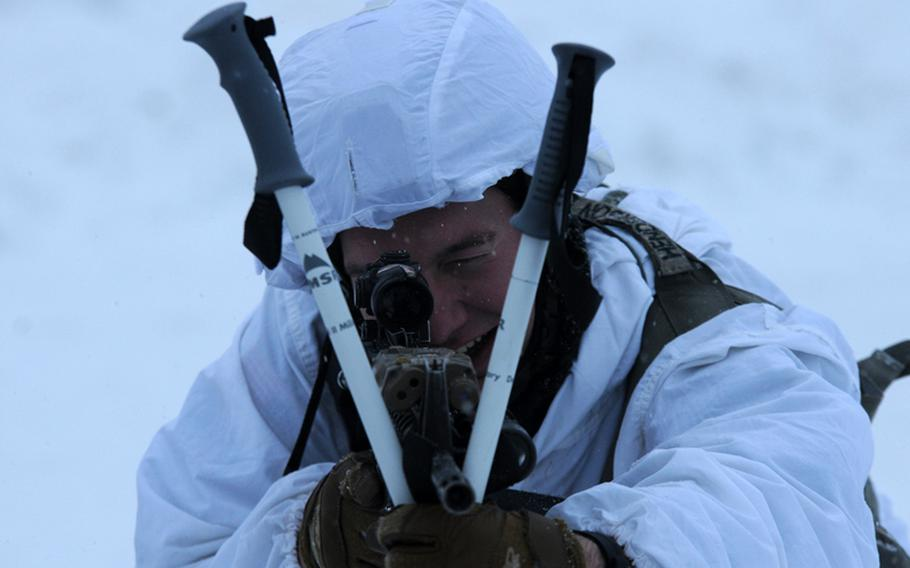 Staff Sgt. Bruce Henderson, an infantryman with 4th Infantry Brigade Combat Team (Airborne), 25th Infantry Division, uses crossed ski poles to steady his aim Dec. 12, 2013 at the Malemute Drop Zone at Joint Base Elmendorf-Richardson, Alaska.