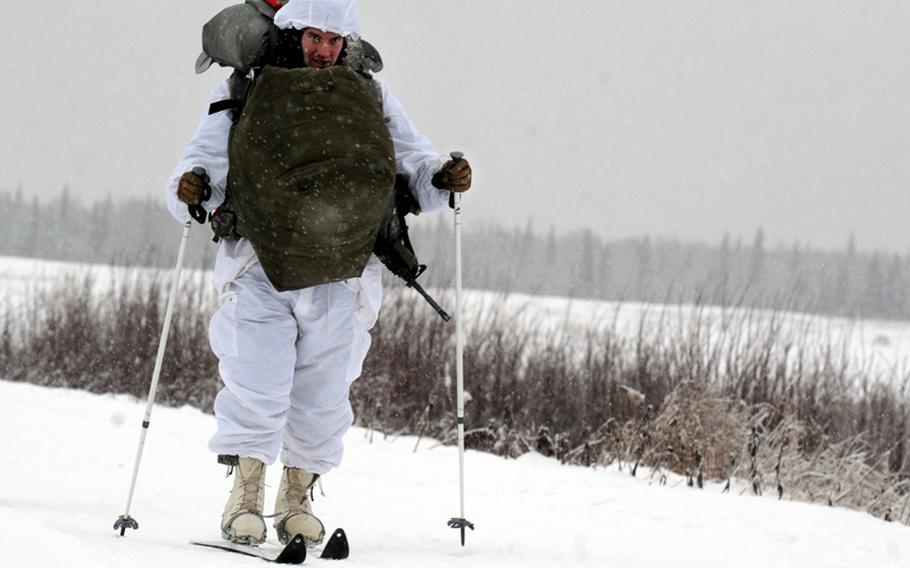 Army Staff Sgt. Bruce Henderson, a native of Keystone Heights, Fla., assigned the 1st Squadron (Airborne), 40th Cavalry Regiment, 4th Infantry Brigade Combat Team (Airborne), 25th Infantry Division, part of U.S. Army Alaska, skis to a rally point after conducting an Arctic airborne operation in the complete over-white uniform on Malemute drop zone at Joint Base Elmendorf-Richardson, Alaska, Dec. 12, 2013.
