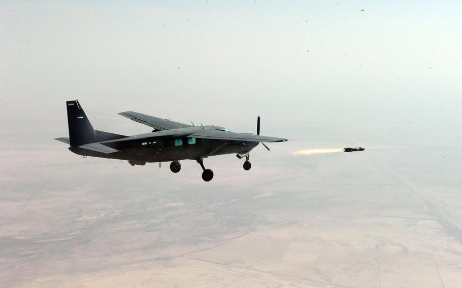 An Iraqi air force pilot fires an AGM-114 Hellfire air-to-ground missile from an Iraqi air force Cessna AC-208 above the Aziziyah test fire range in Iraq on Nov. 8, 2010.