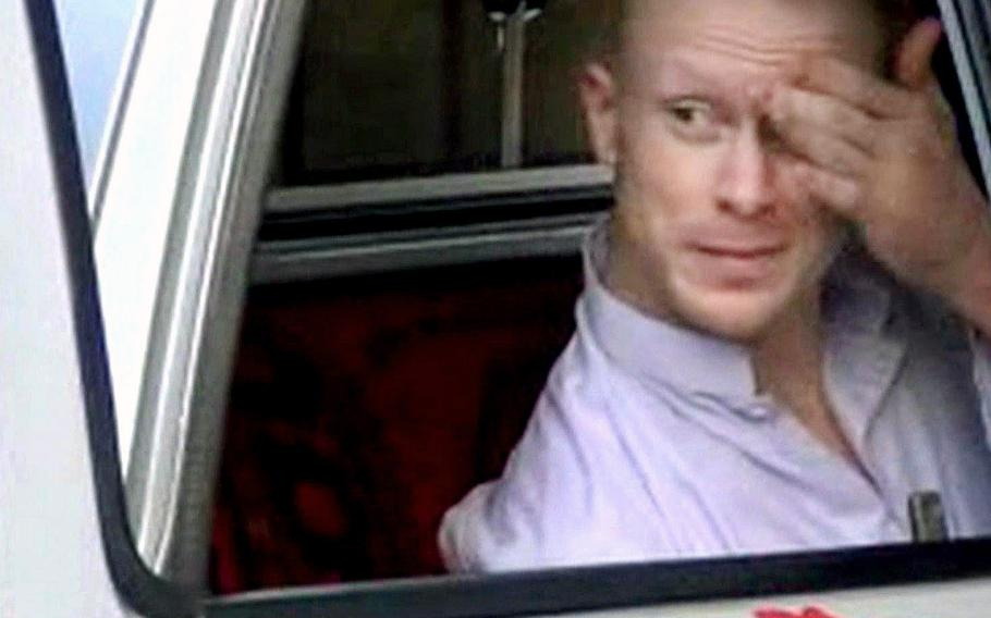 A video screen grab shows Sgt. Bowe Bergdahl sitting in a vehicle guarded by the Taliban in eastern Afghanistan.