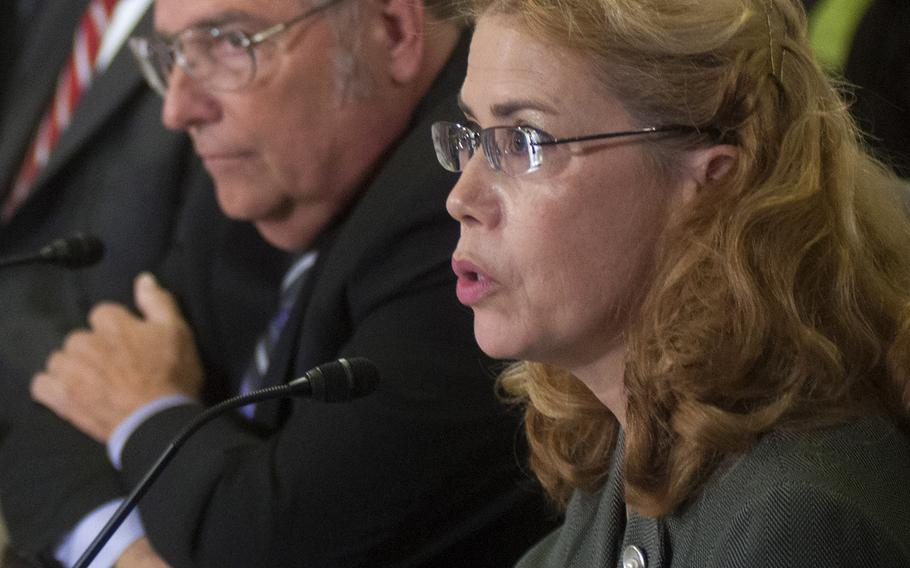 Dr. Katherine L. Mitchell,medical director at the Phoenix VA Health Care System's Iraq and Afghanistan Post-Deployment Center, testifies at a House Committee on Veterans Affairs hearing on the Phoenix VA report on Sept. 17, 2014.