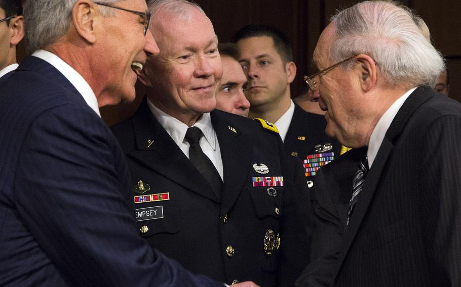 Senate Armed Services Committee Chairman Sen. Carl Levin, D-Mich., greets Secretary of Defense Chuck Hagel and Joint Chiefs Chairman Gen. Martin Dempsey before at a hearing on Capitol Hill in September, 2014.