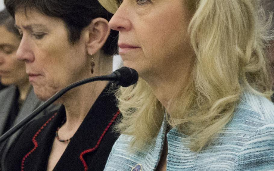 Allison A. Hickey, right, the Department of Veterans Affairs' undersecretary for benefits, at a House Appropriations subcommittee hearing on March 4, 2015. With her is Carolyn M. Clancy, the VA's interim undersecretary for health.