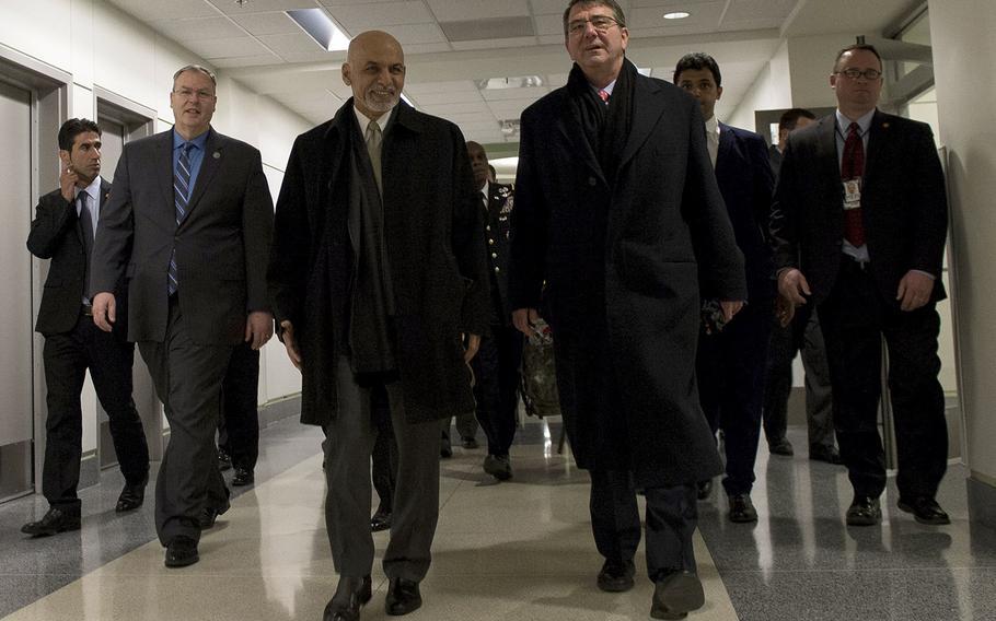 Secretary of Defense Ash Carter walks with Afghan President Ashraf Ghani at the Pentagon, March 23, 2015.
