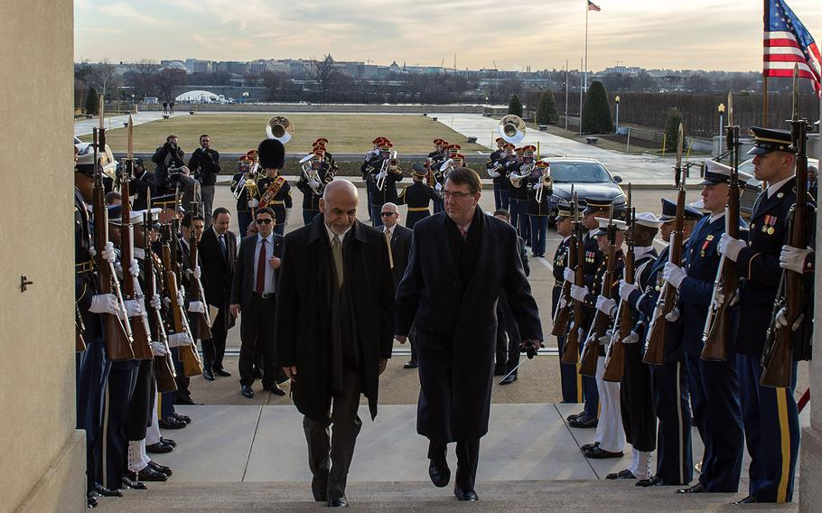 Secretary of Defense Ash Carter walks up the steps to the Pentagon with Afghan President Ashraf Ghani, March 23, 2015.