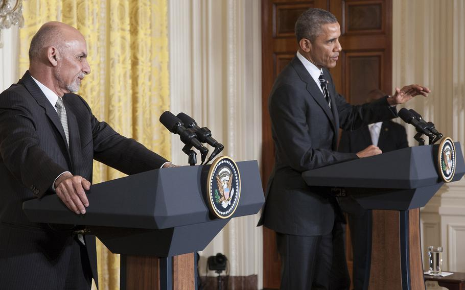 President Ashraf Ghani of Afghanistan listens as President Barack Obama answers a question during a press conference at the White House, Mar. 24, 2015.