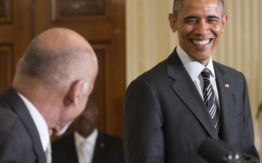 President Barack Obama laughs as President Ashraf Ghani of Afghanistan injects a little levity into a press conference at the White House, Mar. 24, 2015.