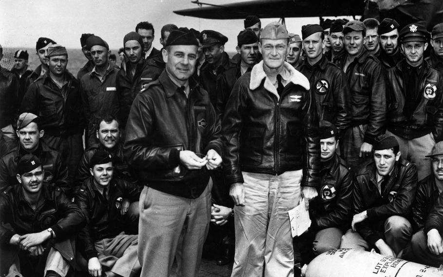 Lt. Col. James Doolittle, left, accepts a medal from the skipper of the USS Hornet, Capt. Marc A. Mitscher. The medal, once given to a U.S. Navy officer by the Japanese, was wired to a 500-pound bomb dropped during the April 18, 1942, bombing of the Japanese mainland.