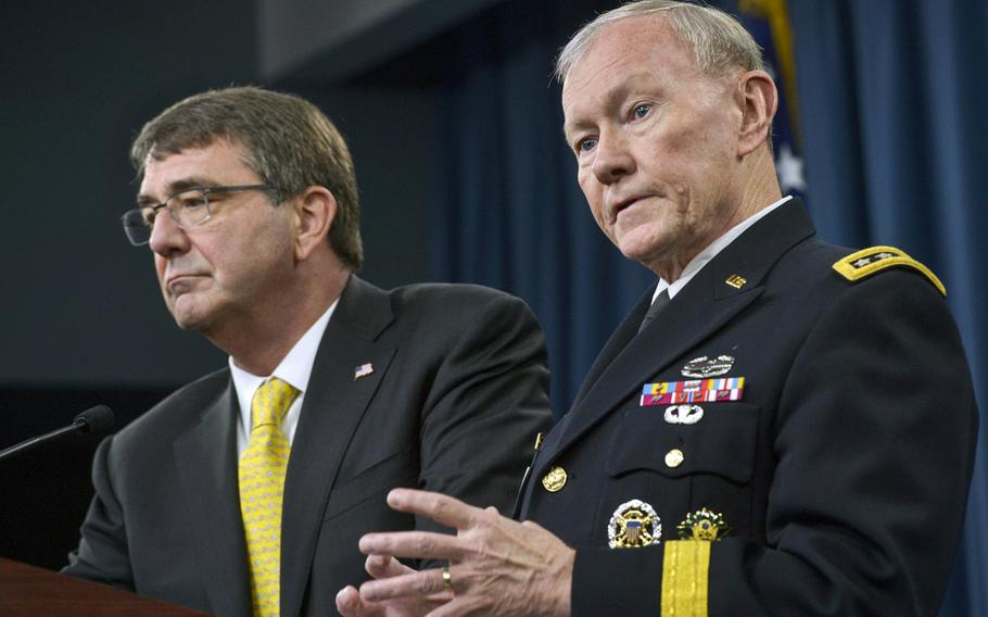 Chairman of the Joint Chiefs of Staff Gen. Martin E. Dempsey answers a reporter's questions as Secretary of Defense Ash Carter listens during a press conference in the Pentagon Briefing Room May 7, 2015.