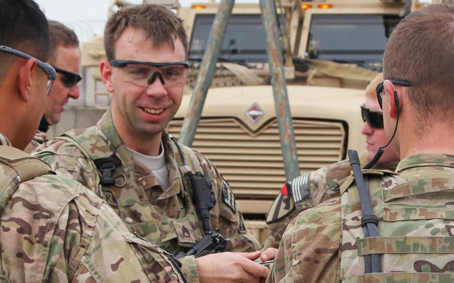 Staff Sgt. Peter King talks to his soldiers at Forward Operating Base Lindsey in Afghanistan, Feb. 5, 2014. King, now Patricia King, is the 1st openly transgender infantryman in the Army.