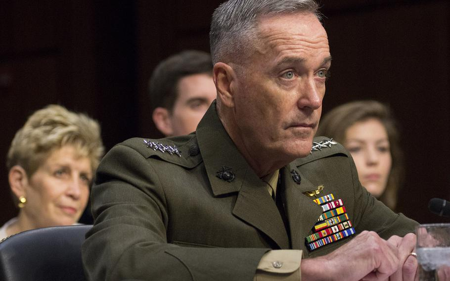 Gen. Joseph F. Dunford, Jr. listens to opening statements during a Senate Armed Services Committee hearing on his nomination as chairman of the Joint Chiefs of Staff on Capitol Hill, July 9, 2015. Behind him are his wife, Ellyn, son Patrick and niece, Jenna Sartucci.