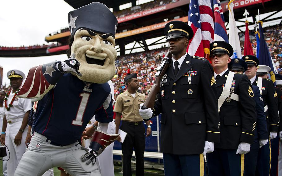 """""""Pat the Patriot,"""" The New England Patriots mascot, poses for a photo with a joint service color guard prior to the beginning of the 2013 National Football League Pro Bowl. Several hundred service members assigned to bases throughout Hawaii were honored during the 2013 Pro Bowl opening ceremonies and halftime show."""