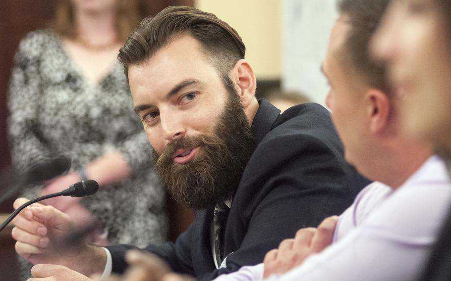 Marine veteran Nicholas Karnaze makes a point while testifying before the Senate Committee on Veterans Affairs Wednesday, Oct. 28, 2015, on Capitol Hill in Washington, D.C. Karnaze said he sought mental health care in the fall of 2014 to discuss concentration and memory issues and was subsequently prescribed medication which sent him spiraling down into depression.