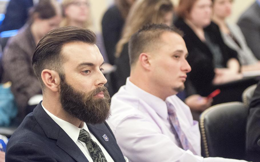 Marine veteran Nicholas Karnaze, left, and Navy veteran Dean Maiers listen to a question as they attend a  Senate Committee on Veterans Affairs hearing on Capitol Hill in Washington, D.C., on Wednesday, Oct. 28, 2015.