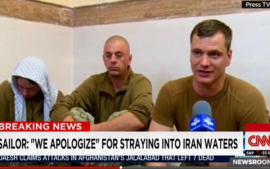 A screen grab of a video where a US sailor apologizes.