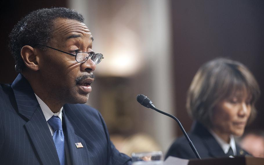 Assistant Secretary of Defense for Health Affairs Jonathan Woodson gives his opening statement during a Senate hearing on Capitol Hill in Washington, D.C., on Tuesday, Feb. 23, 2016. Two panels of witnesses testified before the Senate Committee on Armed Services' Subcommittee on Personnel to discuss options on health care reforms in the Defense Department. At right, Director of the Defense Health Agency Vice Adm. Raquel Bono, listens as Woodson speaks during the second panel session.