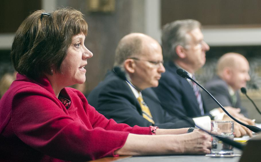 Bernadette Loftus, an associate executive director with the Mid-Atlantic Permanente Medical Group, testifies during a Senate hearing on Capitol Hill in Washington, D.C., on Tuesday, Feb. 23, 2016. Other witnesses joining Loftus in the first of two panel sessions before the Committee on Armed Services' Subcommittee on Personnel are from left: A. Mark Fendrick, the director of the Center for Value-Based Insurance Design; David McIntyre, Jr., president and CEO of TriWest Healthcare Alliance; and John Whitley, Senior Fellow at the Institute for Defense Analyses.