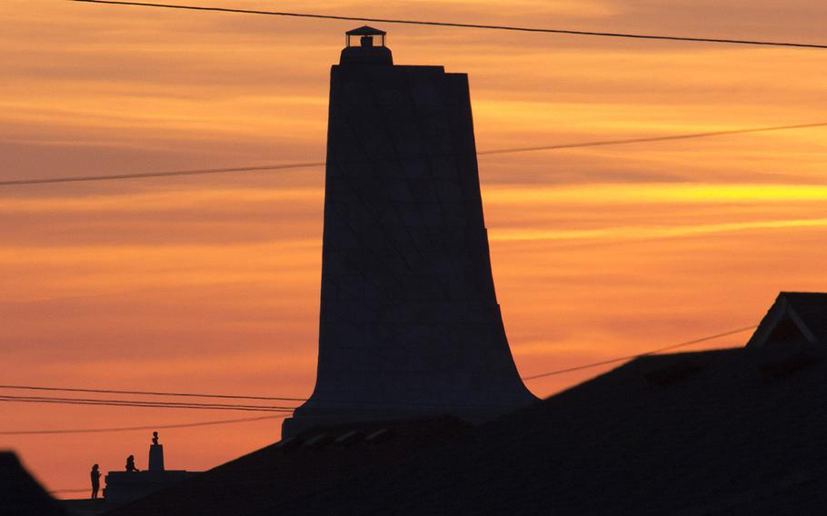 The Wright Brothers National Memorial in Kitty Hawk, N.C., as seen at sunset from the beach.