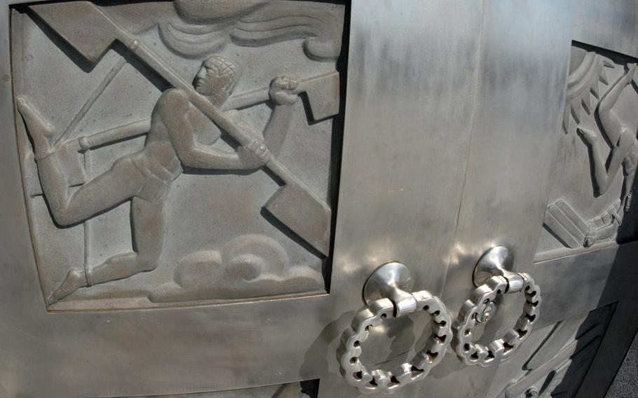 Flight-themed scenes on a door at the Wright Brothers National Memorial in Kitty Hawk, N.C.