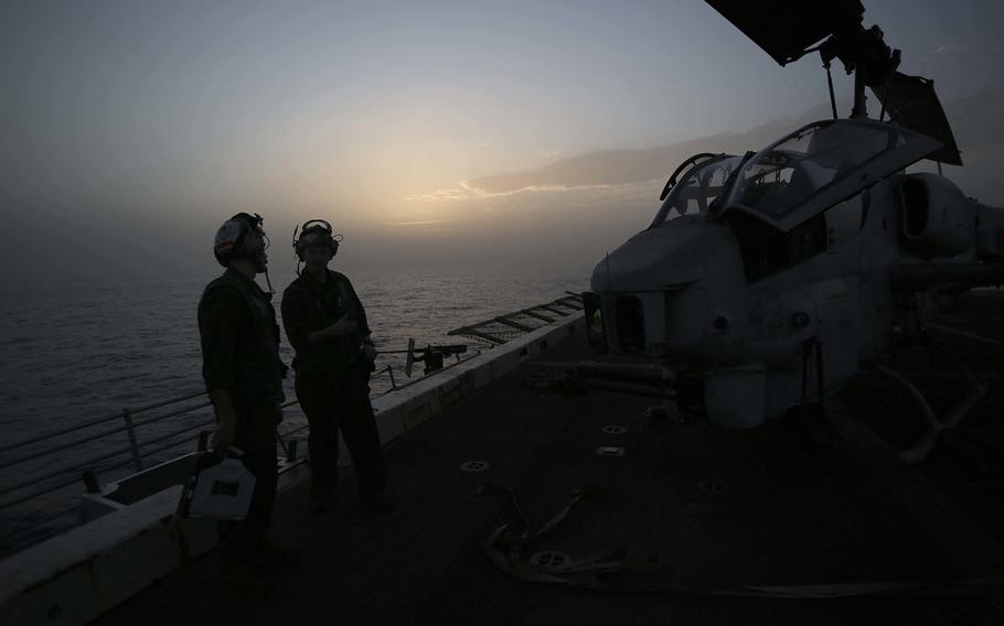 U.S. Marines with 22nd Marine Expeditionary Unit prepare an AH-1W Super Cobra for flight aboard the amphibious transport dock ship USS San Antonio on Nov. 8, 2016. The 22nd MEU is conducting precision air strikes against Islamic State targets in Sirte, Libya, as part of Operation Odyssey Lightning.