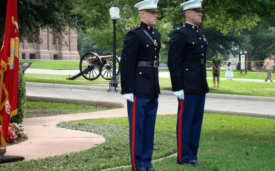 U.S. Marine Corps pilot Capt. Jake Frederick, 32, far left, was killed Wednesday in a F/A-18C crash off Japan. Joe Bob Frederick, right, swore in Jake Frederick, left, at his commissioning ceremony on the grounds of the Texas State Capitol.