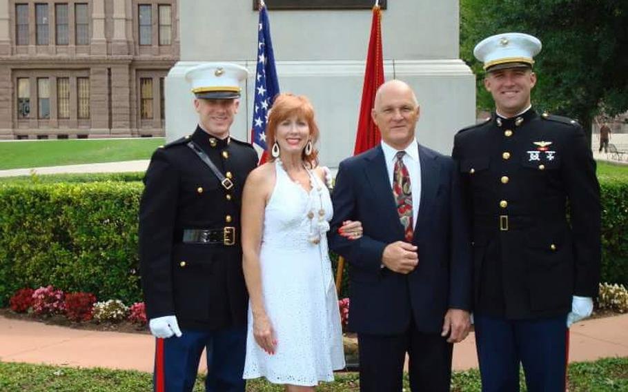 U.S. Marine Corps pilot Capt. Jake Frederick, 32, far left, was killed Wednesday in a F/A-18C crash off Japan. On Thursday, his Texas-based family remembered Jake Frederick's love of flying and his desire to be a Marine. Jake's older brother, Joe Bob Frederick, credited Jake with inspiring him to also join the Marine Corps. Joe Bob Frederick, far right, swore in Jake Frederick, left, at his commissioning ceremony on the grounds of the Texas State Capitol. Also pictured are their parents, Donna Frederick and Larry Frederick.
