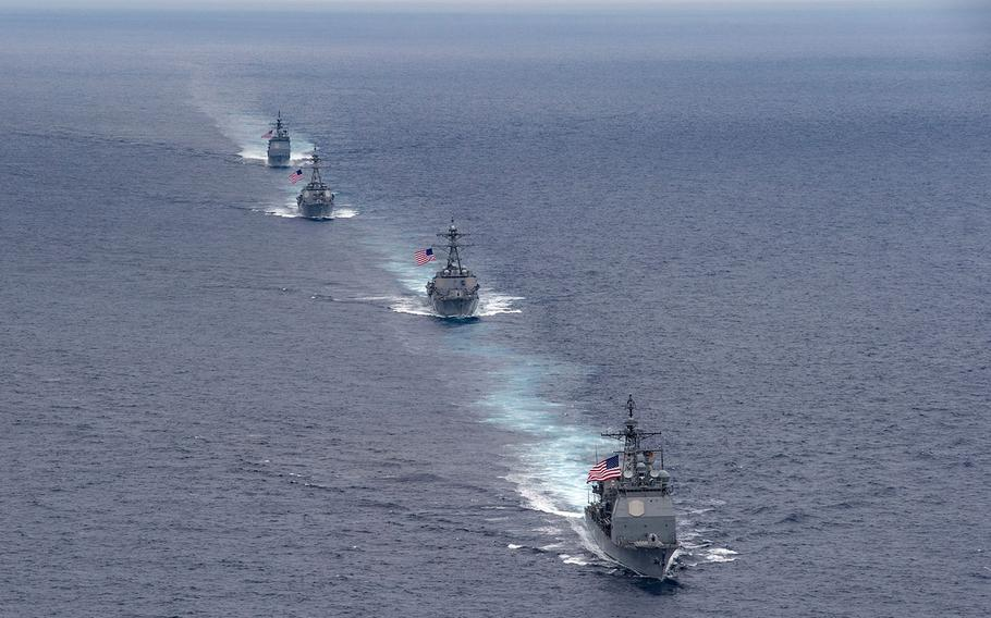 The USS Princeton (CG 59), USS Howard (DDG 83), USS Pinckney (DDG 91) and USS Lake Erie (CG 70), all assigned to Carrier Strike Group 11, steam in formation during a photographic exercise on Aug. 14, 2016.