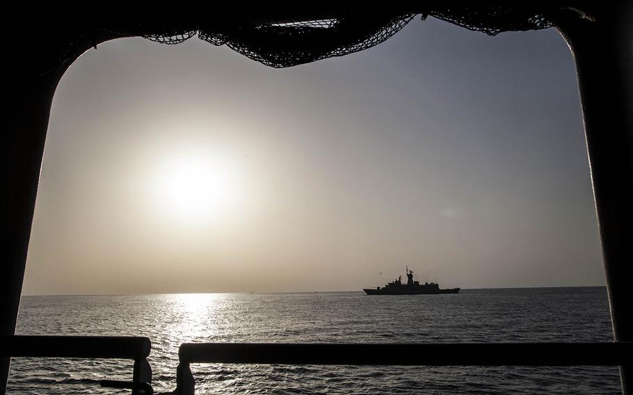 Royale Australian Navy frigate HMAS Arunta passes alongside the Royal Navy helicopter carrier HMS Ocean during exercise Unified Trident in the Persian Gulf Jan. 31, 2016.    Chris Church/Stars and Stripes