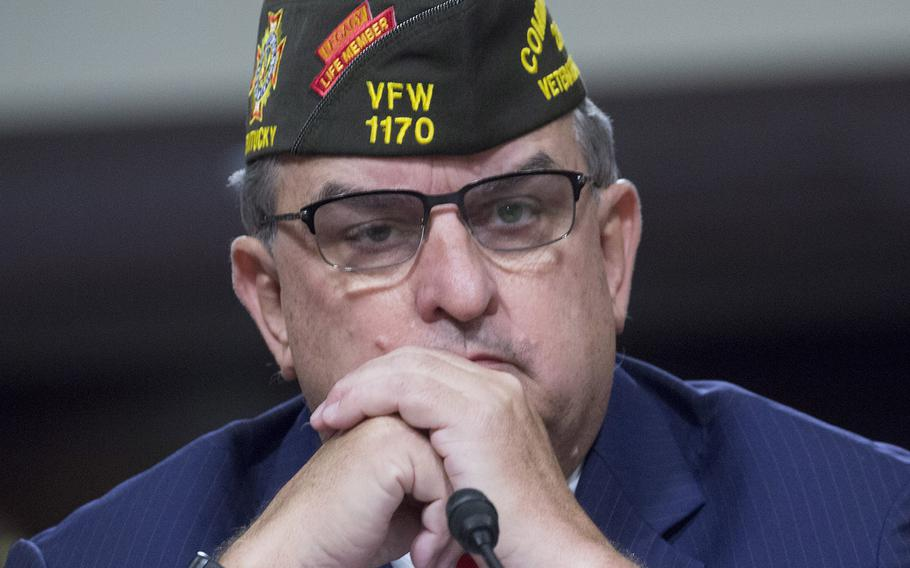 Veterans of Foreign Wars Commander in Chief Brian Duffy listens during the VFW's legislative presentation on Capitol Hill, March 11, 2017.