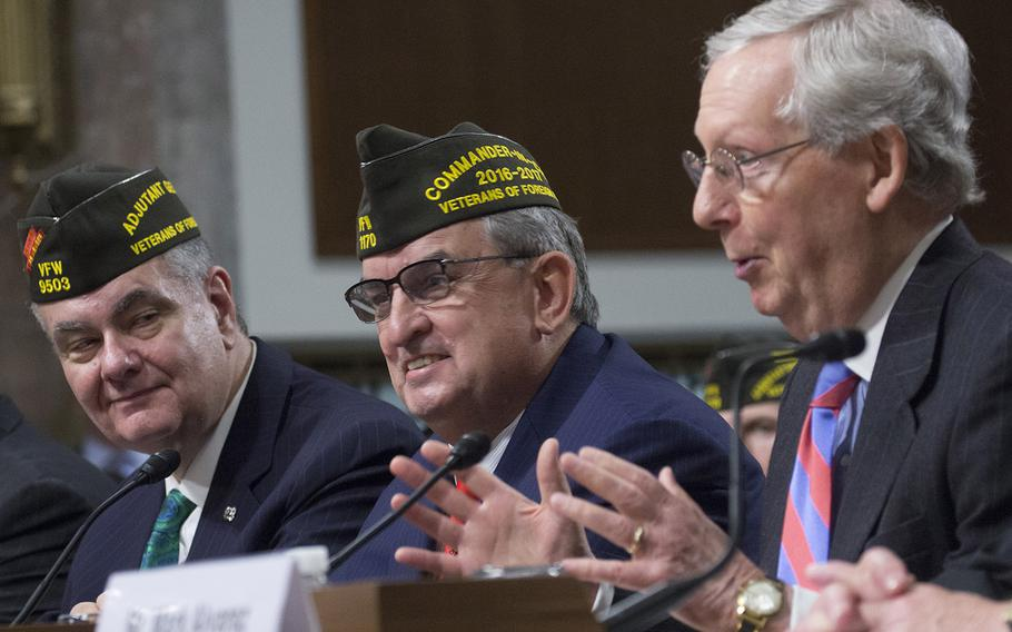 Veterans of Foreign Wars Adjutant General Bob Wallace, left, and VFW Commander in Chief Brian Duffy listen as Duffy is introduced by Senate Majority Leader Mitch McConnell, R-Ky., on Capitol Hill, March 1, 2017.