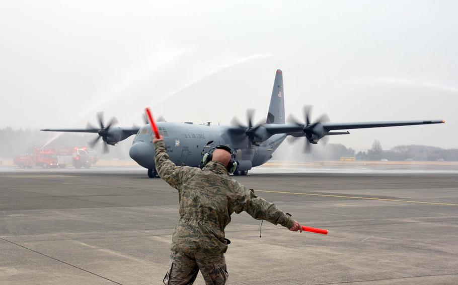 The first of 14 new C-130J Super Hercules cargo planes lands at Yokota Air Base, Japan, Monday, March 6, 2017.