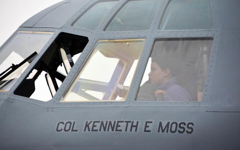 A child checks out the cockpit of a new C-130J Super Hercules aircraft at Yokota Air Base, Japan, Monday, March 6, 2017.