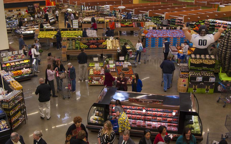 Naval Air Station Jacksonville Commissary shoppers find their way around the new store on opening day on Feb. 2, 2017.