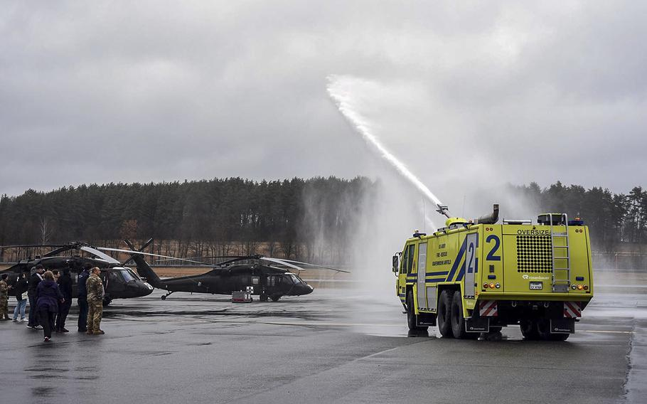 Malik and Damien Nelson, who have a condition called spasticity, are treated to a private vehicle display where water was shot out of a military fire truck, March 18, 2017.