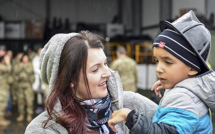 Damien Nelson and his mother Sonja explore military vehicles at a display, March 18, 2017.