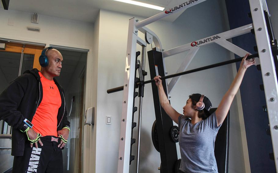 Kianni Martinez and her father, Air Force Lt. Col. Kato Martinez, conduct physical therapy at the Center for the Intrepid at Fort Sam Houston in San Antonio on Feb. 6, 2017. Martinez trains to recover her strength following her injuries in the Brussels airport bombing last March, while preparing for the rigors of Air Force ROTC.