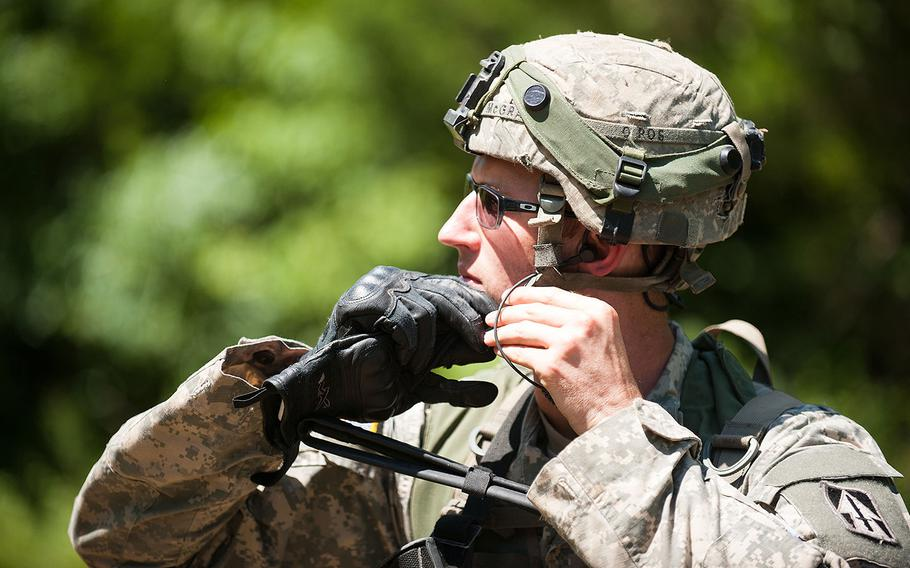 An infantryman with A Company, 1st Battalion, 151st Infantry Regiment, 76th Infantry Brigade, Indiana Army National Guard puts on his Advanced Combat Helmet in preparation for a patrol for mock enemy troops during a training exercise at Camp Atterbury, Indiana, Aug. 8, 2016.
