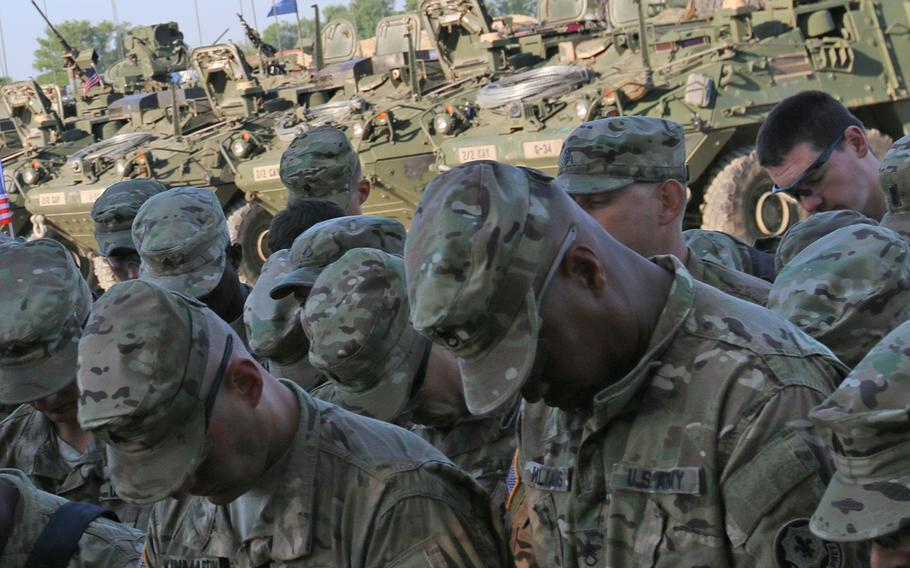 """Soldiers from 2nd Squadron, 2nd Cavalry Regiment, bow their heads in prayer in preparation for Operation Atlantic Resolve's Cavalry March, May 13, 2015. The Chaplain Alliance for Religious Liberty, which advocates for freedom of religious expression in uniform, sent a letter to acting Army Secretary Robert Speer criticizing an Army directive titled """"Promoting Diversity and Inclusion."""""""