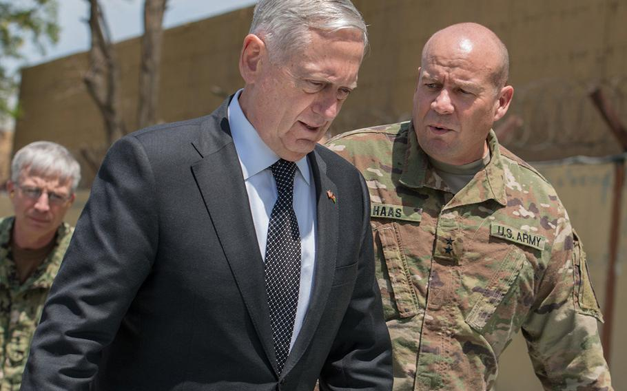 U.S. Defense Secretary Jim Mattis is greeted by Army Maj. Gen. Christopher K. Haas, deputy chief of staff for NATO's Resolute Support operations, as he arrives Monday, April 24, 2017 at coalition headquarters in Kabul, Afghanistan.