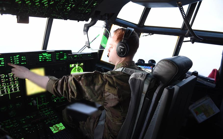 First Lt. Paul Harrington, of Cumberland, R.I., serves as co-pilot on a C-130J flight from Bagram Air Field to Mazar-e-Sharif, May 4, 2017. Harrington, who commissioned in 2013, is on his first deployment to Afghanistan.