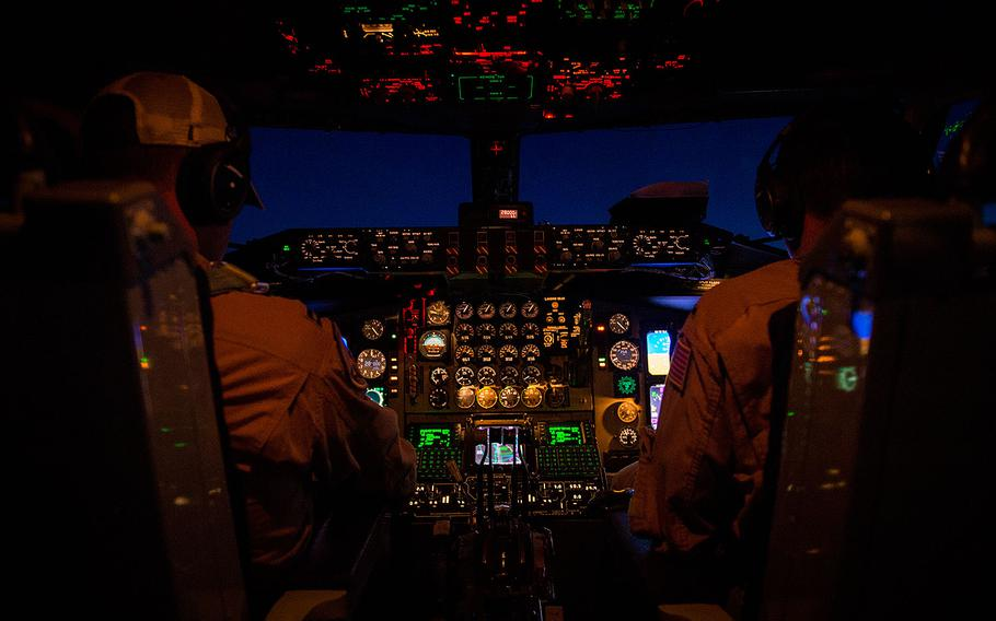 Two U.S. Air Force KC-135 Stratotanker pilots, assigned to the 340th Expeditionary Air Refueling Squadron, perform in-flight checklists during a flight in support of Operation Inherent Resolve April 27, 2017.