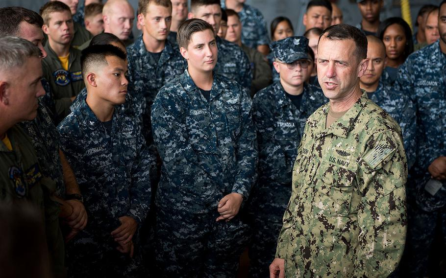 """Chief of Naval Operations Adm. John Richardson meets the crew of the """"Island Knights"""" Helicopter Sea Combat Squadron (HSC) 25 at Andersen Air Force Base on May 17, 2017."""