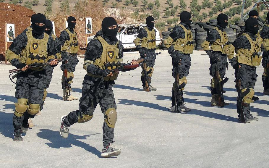 In a March, 2016 file photo, elite fighters with the Kurdish YPG training in Iraqi Kurdistan.