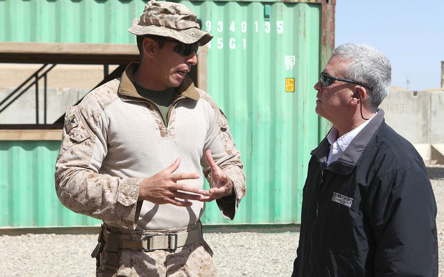U.S. Rep. Brad Wenstrup, R-Ohio, speaks to a Navy corpsman about training at Camp Shorabak, Helmand province, Afghanistan on March 18, 2014. Wenstrup, along with four other members of congress, visited the base to get a firsthand look at the training procedures of the Afghan National Army.