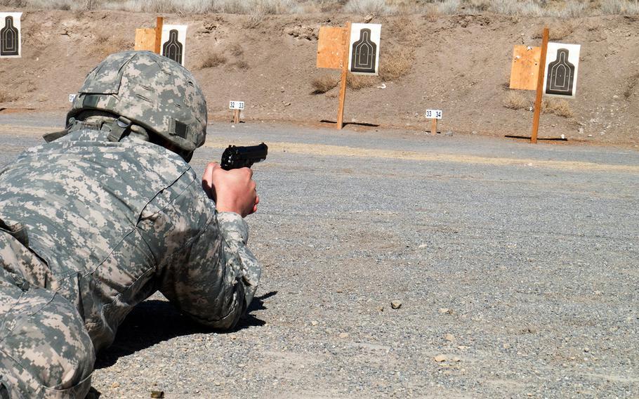 A U.S. Army Reserve soldier fires an M9 Beretta handgun at a firing range on Camp Williams, near Salt Lake City, Utah, March 4, 2017.